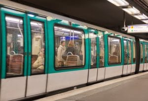 Metro train in a Paris station, France.